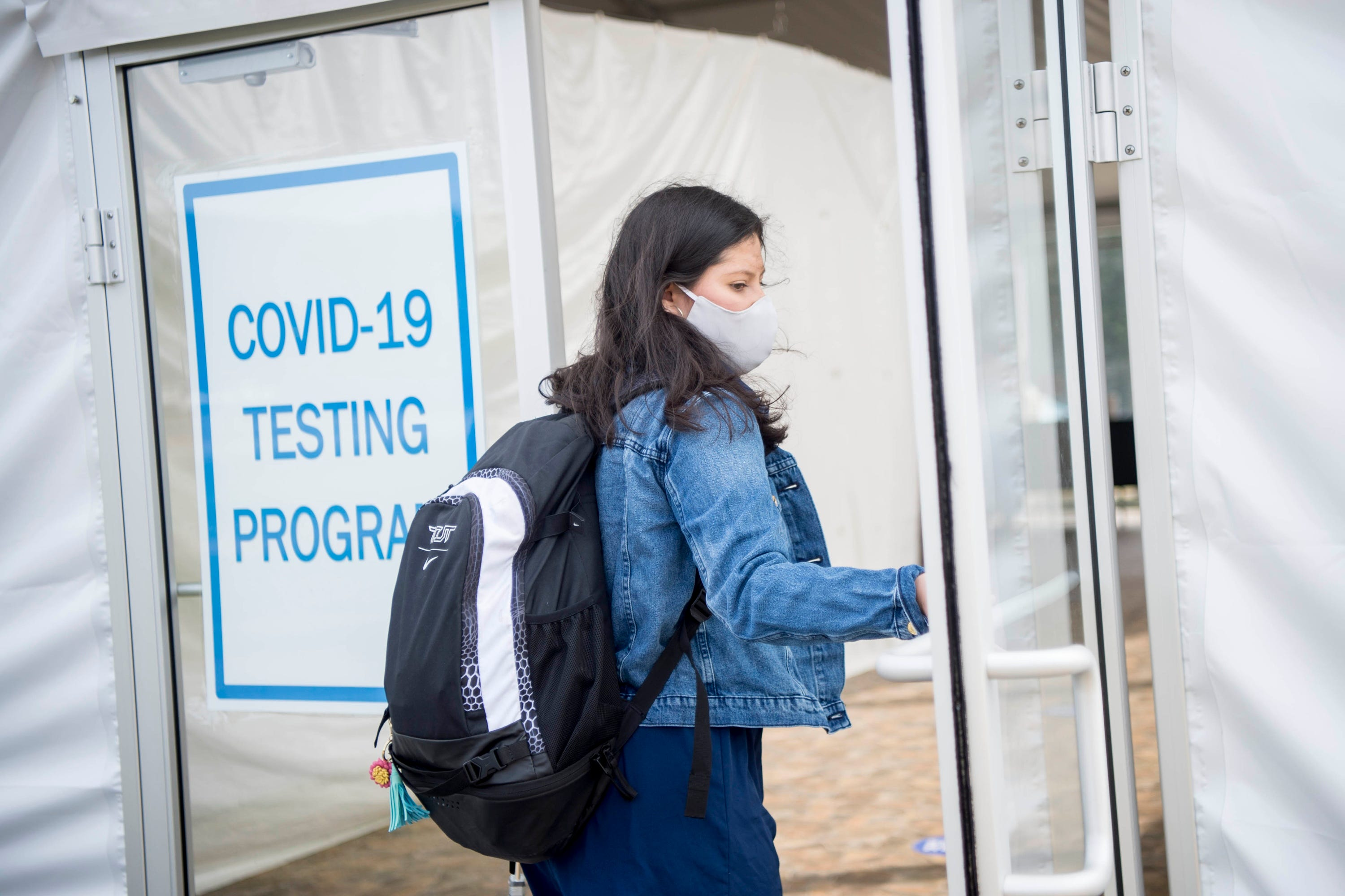 Colby College senior Ashlee Guevara, 21, of Houston, enters the COVID-19 testing site last week on campus.