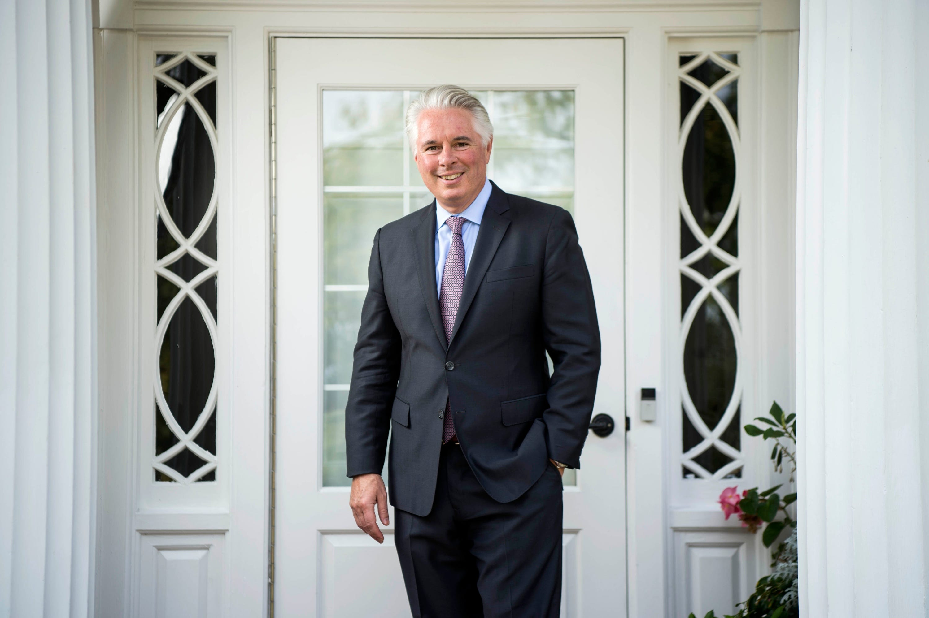 David Greene, president of Colby College, poses for a portrait on the front steps of the Osborne House on the campus in Waterville, Maine.