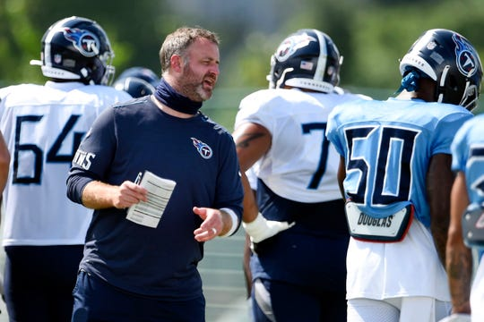 Tennessee Titans outside linebackers coach and defensive playcaller Shane Bowen did not travel to Minnesota for Sunday's game because of COVID-19 protocols.
