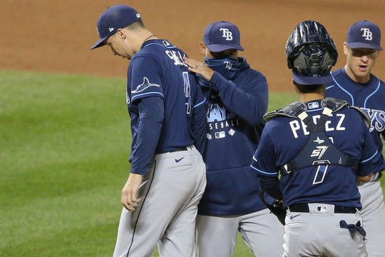Rays manager Kevin Cash relieves starting pitcher Blake Snell.