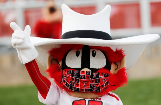 Texas Tech's Raider Red wears a mask during an NCAA college football game against Houston Baptist, on Sept. 12, 2020, in Lubbock, Texas.