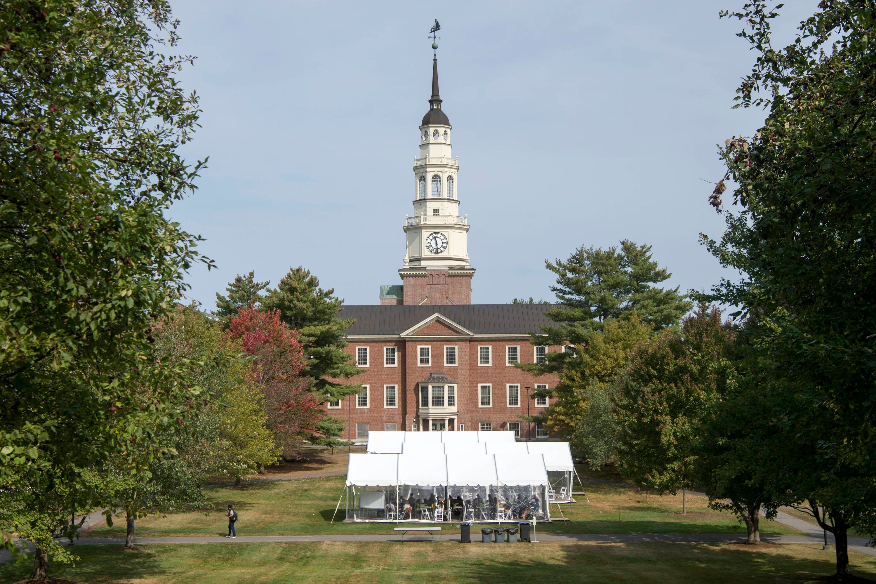 Outdoor classroom tents fill the green space next to Miller Library, seen in the background, as students take in-person classes at Colby College in Waterville, Maine.