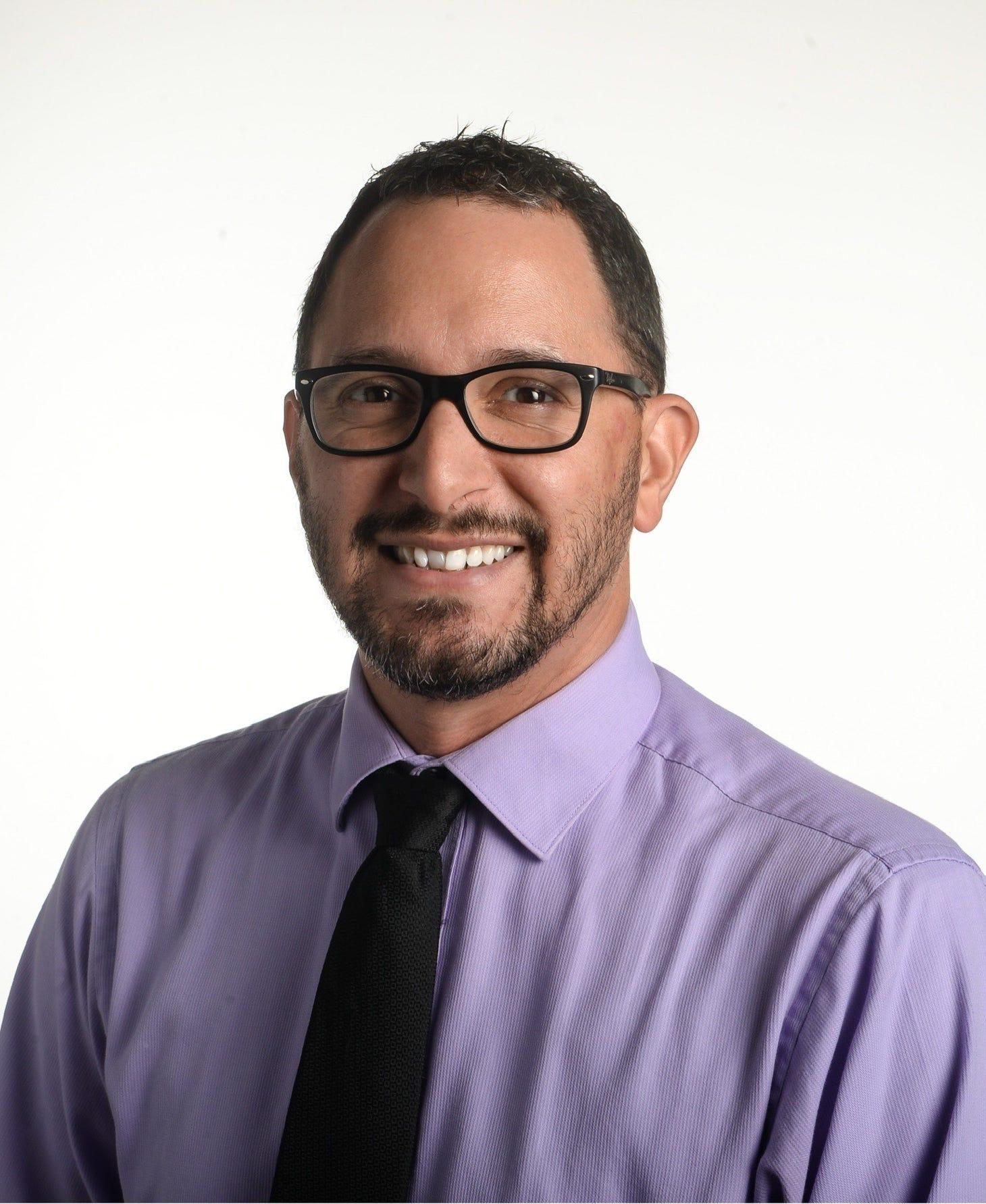 Carlos R. Munoz