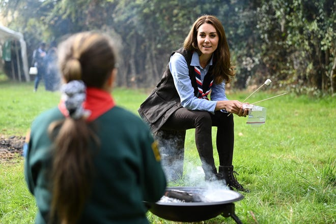 Duchess Kate toasts marshmallows during her visit to a Scout Group in Northolt, northwest London on September 29, 2020, where she joined Cub and Beaver Scouts in outdoor activities.