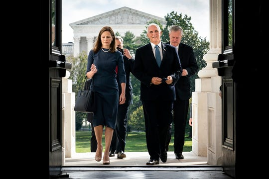 Judge Amy Coney Barrett, President Donald Trump's nominee to the Supreme Court, and Vice President Mike Pence arrive at the Capitol where she will meet with senators Sept. 29, 2020, in Washington, D.C.