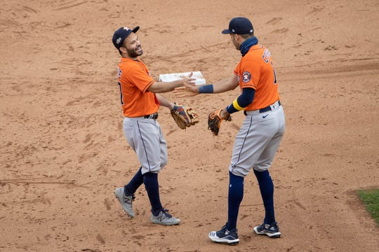Jose Altuve and Carlos Correa celebrate after the final out.