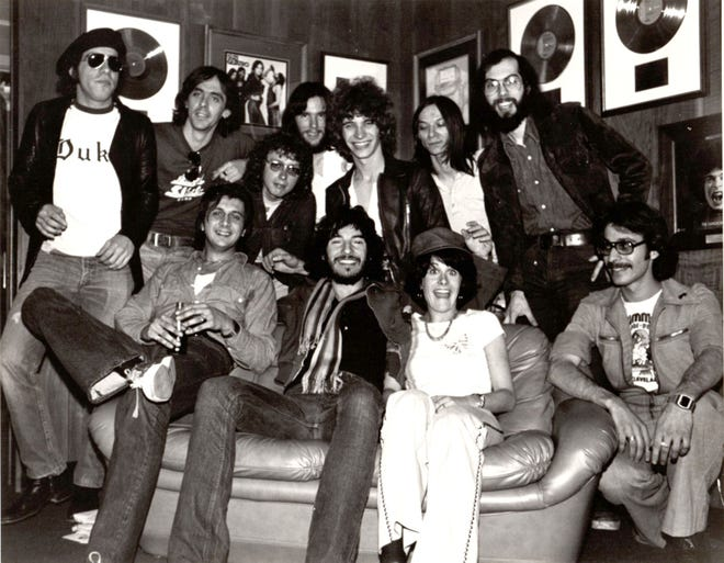 Newly retired radio man Jeff Kinzbach (back row, center) hangs out with a young Bruce Springsteen during his visit to Cleveland in 1976.
