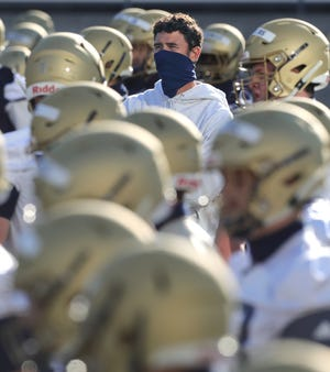 University of Akron head coach Tom Arth keeps an eye on players conditioning during practice on Wednesday, Sept. 30, 2020 in Akron, Ohio, at InfoCision Stadium. [Phil Masturzo/ Beacon Journal]