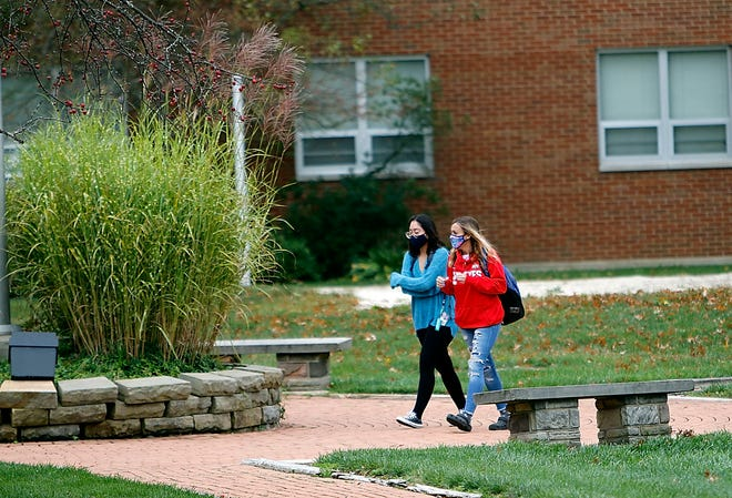 Dr. Richard Lofgren, president and CEO of University of Cincinnati Health, said Monday that personal behavior — wearing masks (as these Ashland University students are doing), social distancing, avoiding crowds and being careful with family gatherings—can help turn around the spike in COVID-19 cases.