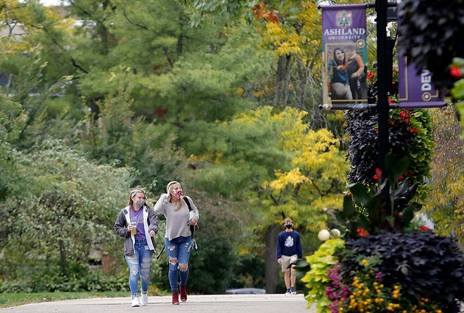 Ashland University students walk down the Avenue of the Eagles behind Founder's Hall on the campus on Wednesday, Sept. 30, 2020. TOM E. PUSKAR/TIMES-GAZETTE.COM
