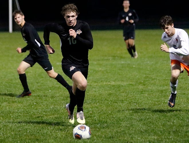 Ashland's Andrew Mills brings the ball down the field during a game last season.