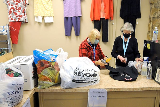 The Ashland Senior Citizen Center Thrift Shop, Bargains in the Belfry volunteers Nedra Lautzenhiser and Penny Kaufmann work at preparing for the ever-popular bag sale, Saturday, Oct. 17.