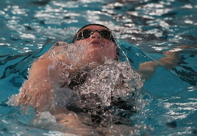 Ames senior Mia Moulden swims during the 200-yard individual medley in a dual meet against Marshalltown at the Ames Swimming Pool Tuesday. Moulden and the Little Cyclones were thrilled to finally get a home meet in and they celebrated the occasion with a 140-45 victory.