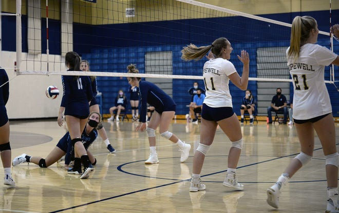 Hopewell's Rachel Katekovich (11) and Leah Driscoll (21) celebrate a point against Central Valley at Hopewell High School on Tuesday.