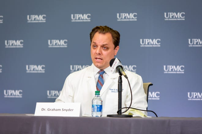 Dr. Graham Snyder, medical director of infection prevention and hospital epidemiology at UPMC, speaks Tuesday during a press briefing.