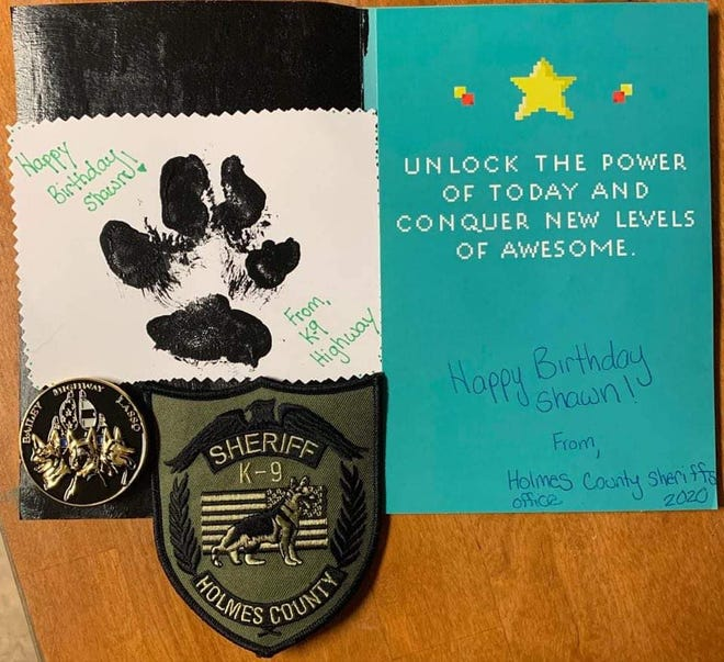 The card, patch and coin sent to Shawn by HCSO Deputy Jeremy Abbott and K-9 Highway.