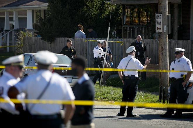 Columbus police investigate a scene where three people were shot, two fatally, in the Hilltop neighborhood, Saturday, September 19, 2020.  Lionel Adams, 60, and Candace Carr, 41, died inside 511 S. Wheatland Ave. Their deaths were the city's 109th & 110th homicides in 2020. Rianne Dotson, 34, was transported to OhioHealth Grant Medical Center in critical condition.