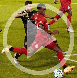 Richie Laryea outmaneuvers Crew defender Milton Valenzuela to score a goal for a 3-1 Toronto lead during Sunday night's game.