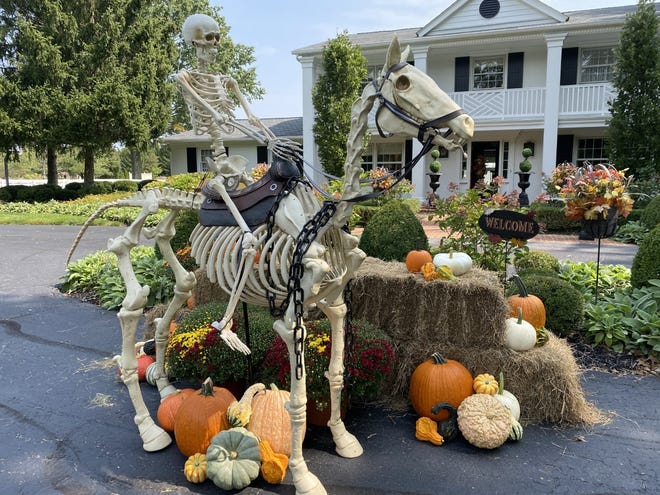 Ride 'em, cowbones! Carroll Bowman's display is quite appropriate outside her Blacklick horse farm.