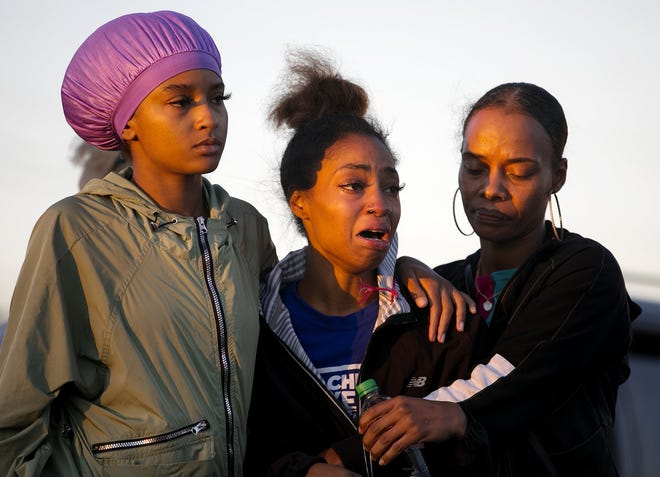 Alexias Carr, center, is supported by friends as she learns that her mother, Candace Carr, 41, was one of the victims in a fatal shooting on the Hilltop Sept. 19. Also killed was 60-year-old Lionel Adams, and a third person was injured. [Courtney Hergesheimer/Dispatch]