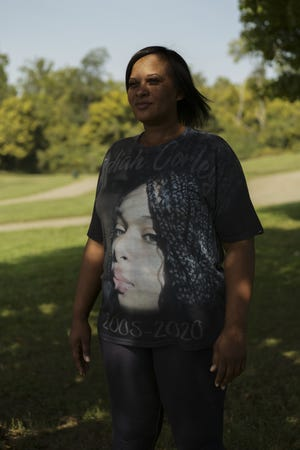 Wearing a shirt with a picture of her slain 14-year-old daughter, Indiah on it, Heather Corley poses for a portrait on Sept. 23 at Noe-Bixby Park in Columbus.