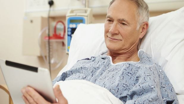 The tablet-based application in each room allows TGMC's patients to take control of their healthcare with real-time information.