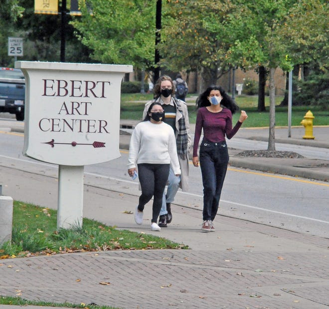 College of Wooster students, wearing face masks, stroll through campus on Sept. 30, 2020.