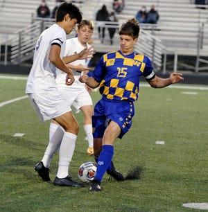 Lexington Teddy Togliatti and Wooster Jaden Boucher battle for possession.
