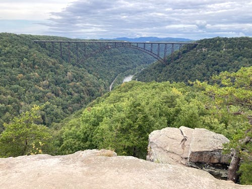 The view of the New River Gorge Bridge at the end on Long Point Trail in Fayetteville is spectacular.