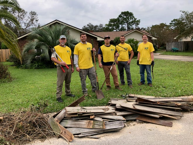 A team of volunteers from Fort Walton Beach help out in Pensacola.