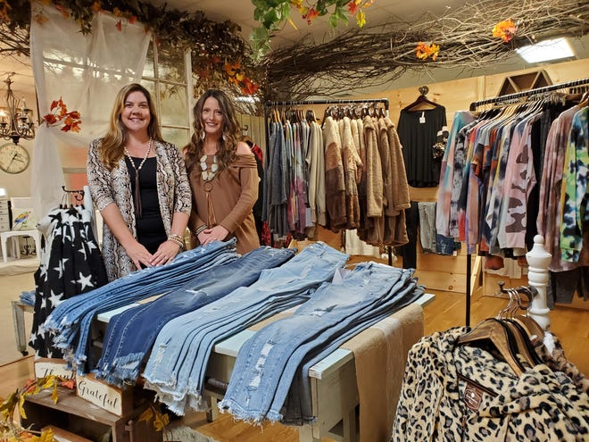 Jennifer Berrier(from left) and Angie Hodges have opened Sweet Southern Sass, a women's boutique offering new clothing, jewelry and other accessories inside Evenbrooke Marketplace in Lexington.