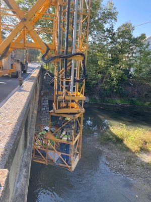 A bridge platform crane was used to take Pennsylvania Department of Transportation inspectors under the bridge over the Conococheague Creek on Worleytown Road in Antrim Township last week.