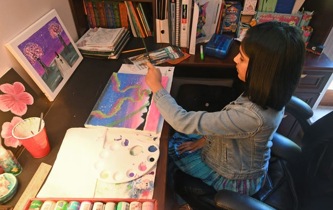 "Advika Anand works on a painting in June at her home in Millcreek Township. Anand, a fifth-grader at Grandview Elementary School, loves to paint and has been building a body of completed work, even during COVID-19 school restrictions. ""We have an art class assignment posted every week,"" she said. ""I've been doing well, keeping up with my work, and I've figured out all my art projects."""