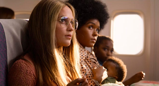 "Alicia Vikander portrays Gloria Steinem, left, and Janelle Monae stars as Dorothy Pitman Hughes in a scene from ""The Glorias"" on Amazon Prime."