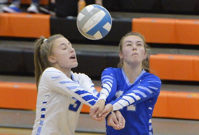 Villa Maria Academy sophomore Hailey Sliker, left, and Karlee Kieklak go for a ball Tuesday against McDowell High School at the Joann Mullen Gymnasium, Hagerty Family Events Center in Erie.