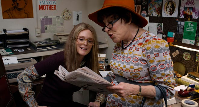 "Julianne Moore stars as Gloria Steinem, left, with Bette Midler as Bella Abzug in a scene from ""The Glorias."""