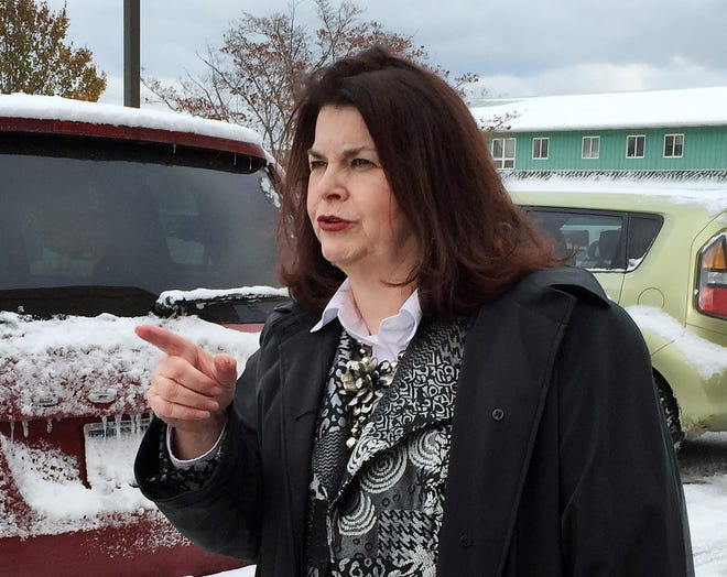 Laura J. Eaton gestures while talking to the media outside the office of a Millcreek Township district judge on Nov. 21, 2104, after she was arraigned on felony charges of theft, receiving stolen property and criminal trespass related to what was the J.O.Y. Center, for Just Older Youth, on Legion Road. The Erie County District Attorney's Office dismissed the charges and Eaton sued Millcreek officials and the township in U.S. District Court in Erie. [FILE PHOTO/ERIE TIMES-NEWS]