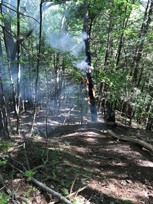 Forest Rangers arrive at a Hemlock Lake fire.