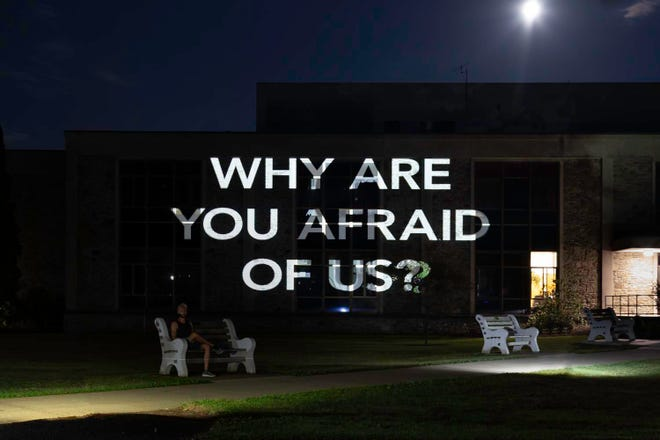 Houghton College alumni artists Joshua Duttweiler and Amy Coon have created a lightshow on campus geared toward raising awareness of the problems facing the LGBQT+ community.