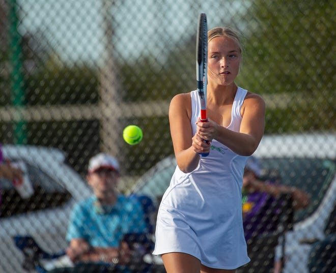 Blue Springs South's Molly Wells hits a backhand return in her singles match against Blue Springs' Kameryn Bush in Tuesday's match at Young Park. Wells defeated Bush 10-1 to help the Jaguars to a 7-2 victory.