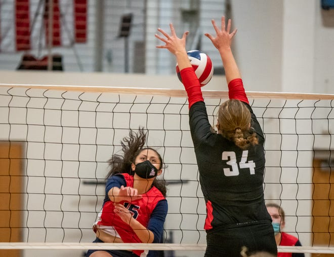 Fort Osage's Kendra Siefker (34) tries to block a spike by Truman's Sarina Ulberg (15) in Tuesday's Suburban Middle Six Conference match at Truman. Ulberg tallied 13 kills and 11 assists to help lead the Patriots to a 3-0 victory.