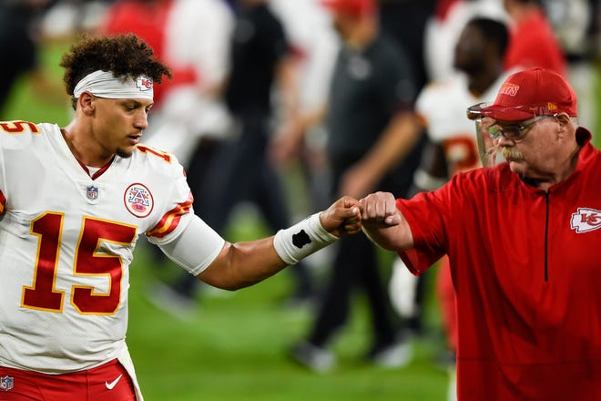 Kansas City Chiefs quarterback Patrick Mahomes (15) and head coach Andy Reid bump fists after defeating the Baltimore Ravens Monday. Mahomes again proved why warranted a large contract extension as the Chiefs remained unbeaten.