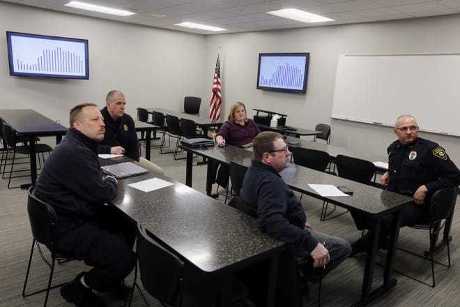 In this file photo Shana Krogmeier, the director of Des Moines County's emergency communications service, DesCom, center, meets with advisory board members from left Burlington Fire Department Chief Matt Trexel, West Burlington Police Chief Jesse Logan, Danville Fire Department Assistant Chief Allen Schillie and Burlington Police Chief Dennis Kramer Feb. 21, 2019 at the Burlington Police Station.
