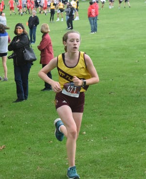 Mount Pleasant High School's Isabelle Meador races to a third-place finish in the girls varsity race at the Washington Invitational on Tuesday. Mount Pleasant won the team title with 34 points.