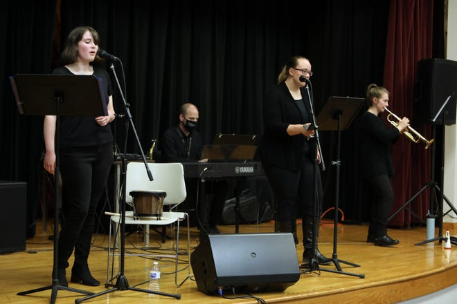 Abigail Johnson, left, a member of the Old Blue Jazz Collective, sings Monday, Sept. 28, as she takes part in a concert for faculty and students in SCC's Little Theater in West Burlington. Johnson is joined by her instructor, Daniel Pappas, Elizabeth Caston and Laura Carpenter.