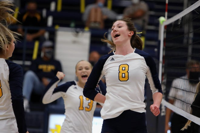 Notre Dame High School's Gabriella Deery (8) celebrates a point with teammates during their match against Central Lee High School,Tuesday, Sept. 29, at Notre Dame's Father Minett Gymnasium.