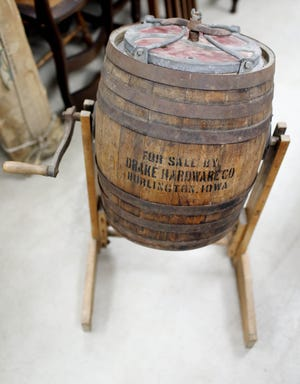 A barrel butter churn, an Out of the Attic item, is shown July 21 at the Des Moines County Heritage Center Museum, 501 N. Fourth St., in Burlington.