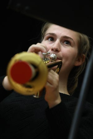 Laura Carpenter, a member of the Old Blue Jazz Collective, a group made up of students in Southeastern Community College's Daniel Pappas Jazz Ensemble class, plays the trumpet Monday, Sept. 28, as she takes part in a concert for faculty and students in SCC's Little Theater. The concert, the ensemble's fist performance of the semester, originally was going to be in the school's courtyard but had to be moved indoors due to the weather.