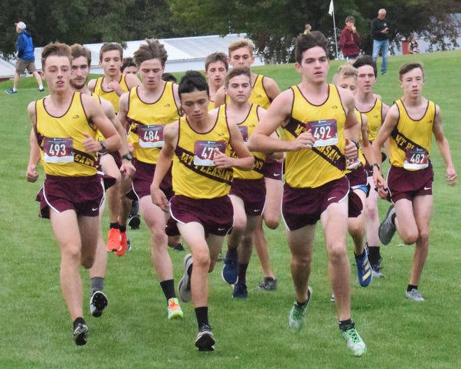 The Mount Pleasant High School boys cross country team takes off at the start of the Washington Invitational on Tuesday.