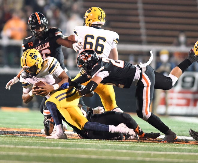 Massillon's Jaidan Wise helps to bring down St. Ignatius quarterback Jaxon French during the Tigers' Week 5 win.
